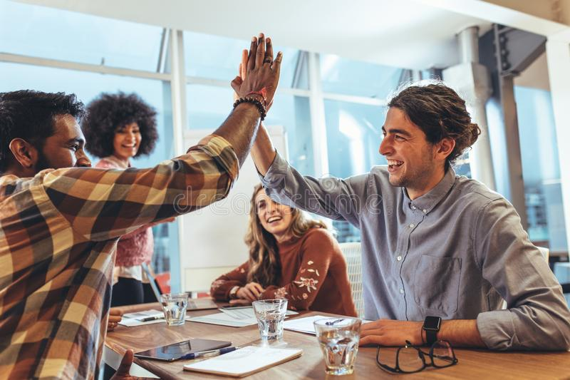 Business colleagues giving high five royalty free stock images