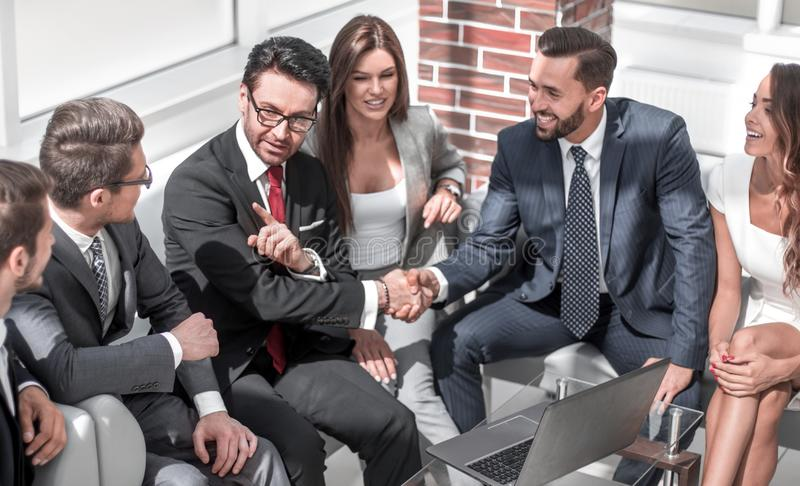Business colleagues greet each other at an informal meeting royalty free stock photos