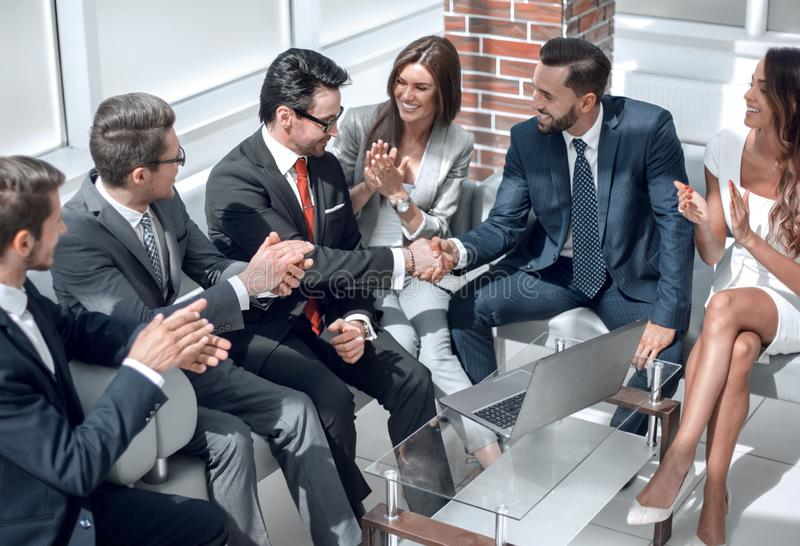 Business colleagues greet each other at an informal meeting stock images