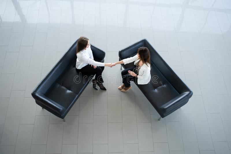 Business colleagues handshake. Businesswomen shaking hands after a successful meeting stock photography