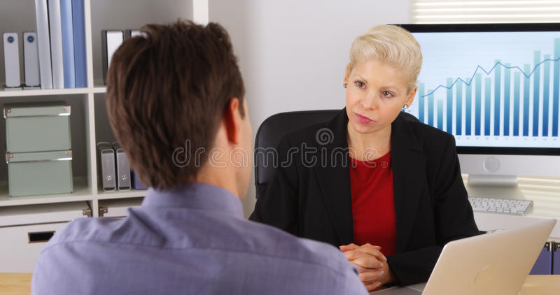 Business colleagues having a discussion in the office royalty free stock photography