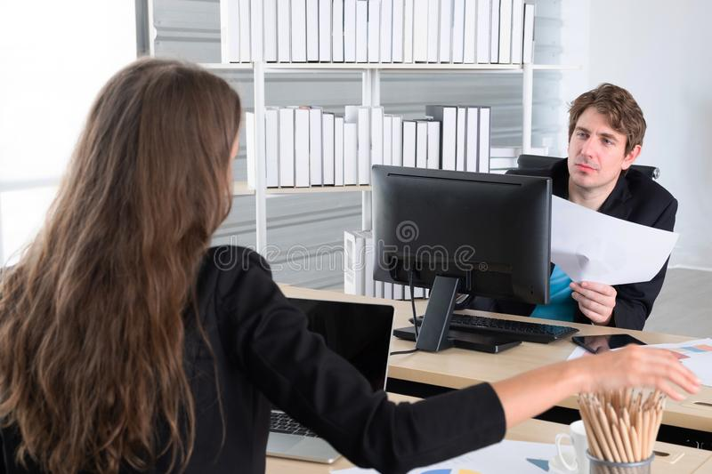 Business colleagues having meeting in the home office, or two young coworkers working on laptop computer at modern office stock photo