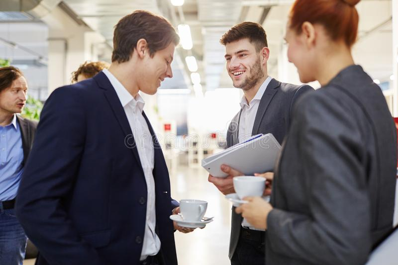 Business colleagues making small talk stock images
