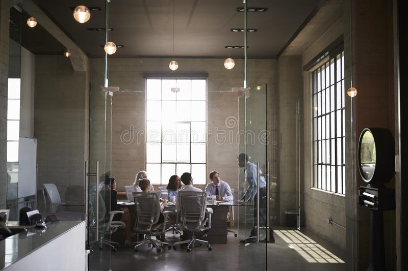 Business colleagues at a meeting in a glass walled boardroom royalty free stock photos