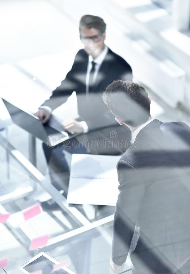 Business colleagues in a modern office royalty free stock image