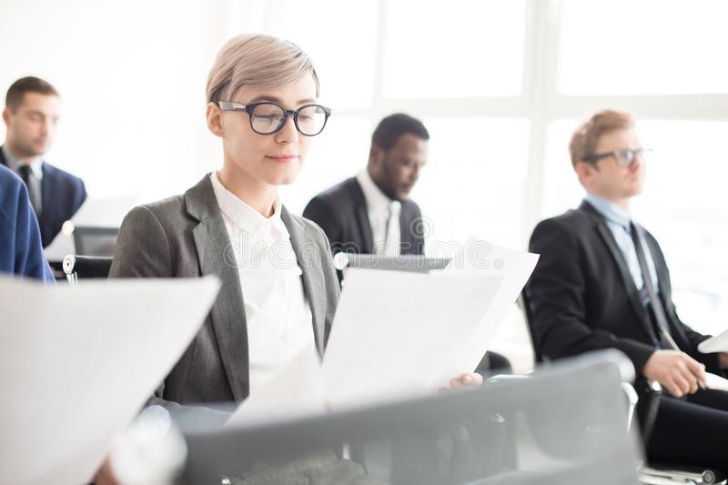 Business colleagues with papers on meeting stock photo