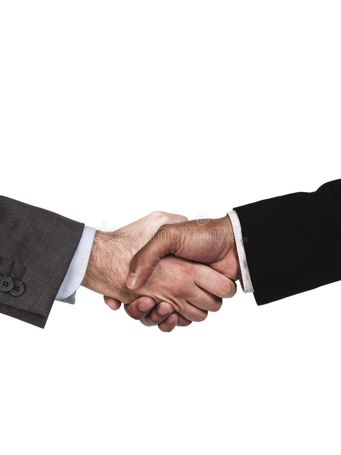 Business colleagues shaking hands over success stock photography