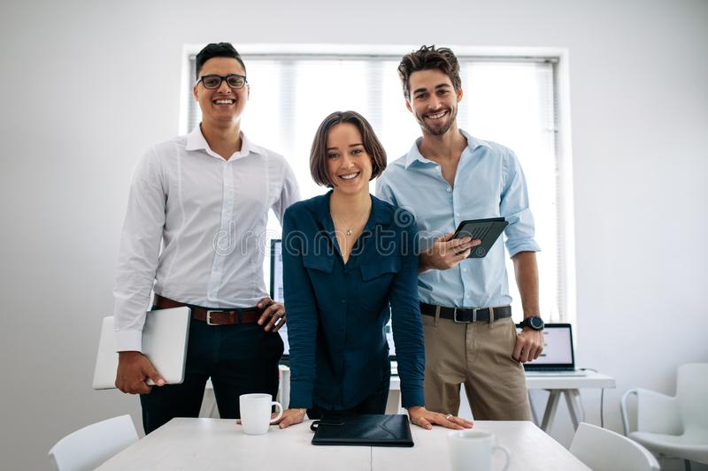 Business colleagues standing in meeting room royalty free stock images