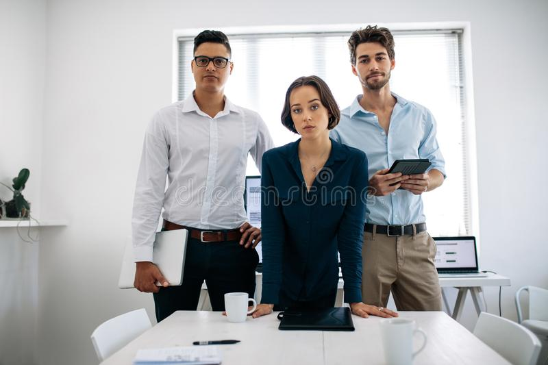 Business colleagues standing in meeting room royalty free stock image