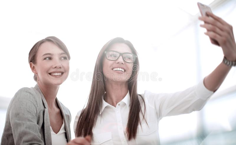 Business colleagues take selfies in a bright office stock photography