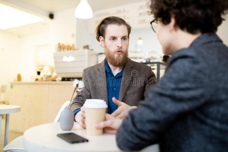 Business colleagues talking in coffee shop royalty free stock photos