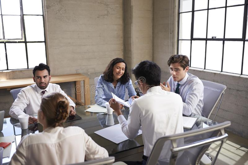 Business colleagues talking in a meeting room stock image