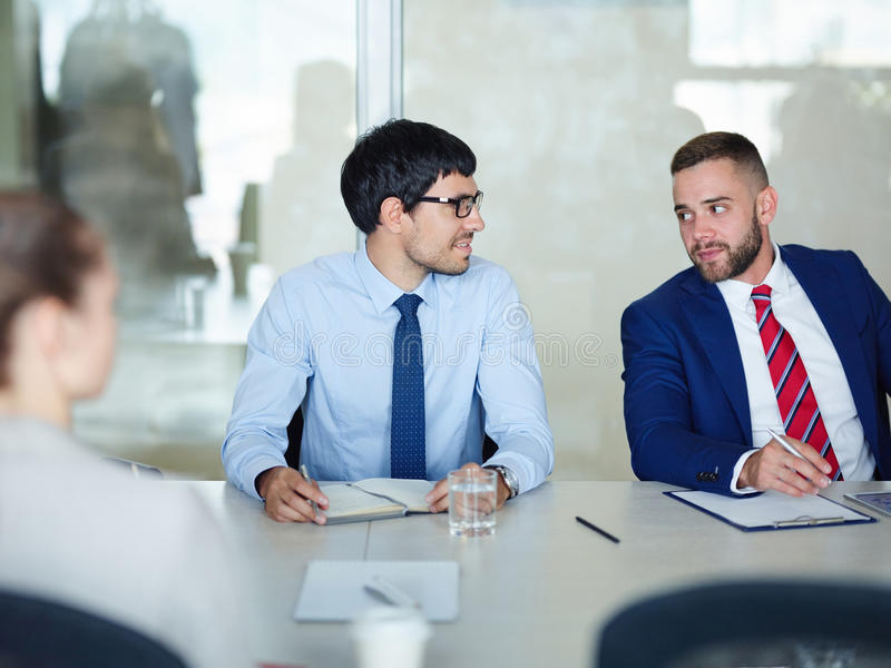 Business Colleagues Talking at Meeting Table stock photos