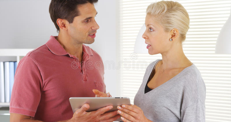 Business colleagues talking with tablet stock photography