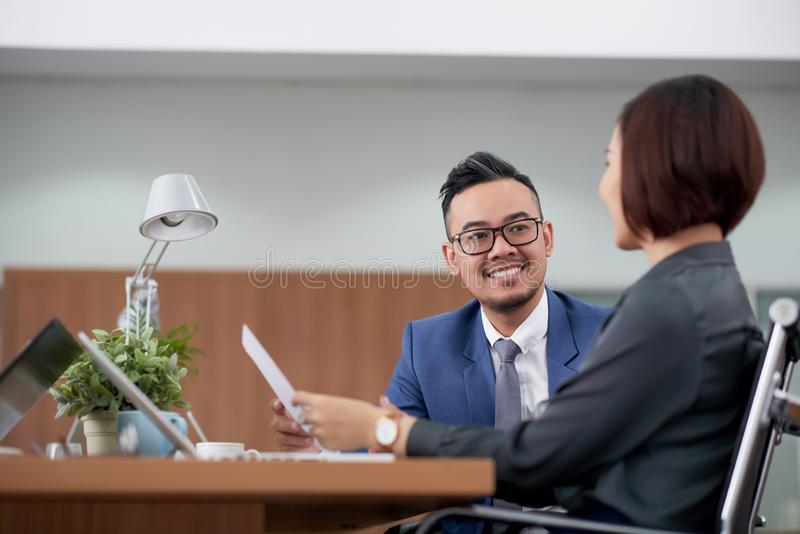 Business colleagues talking to each other at office royalty free stock image