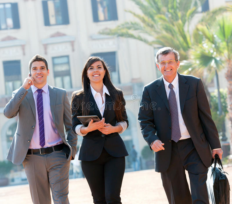 Download Business Colleagues Walking Outdoors. Stock Photo - Image: 24834886