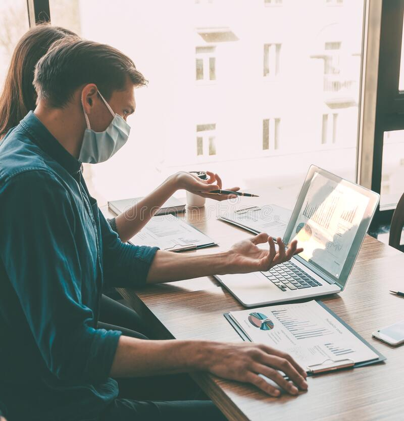 Business colleagues work in the office during the quarantine period. stock images