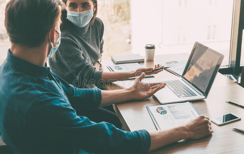 Business colleagues work in the office during the quarantine period. stock photography