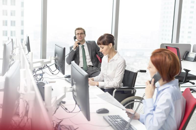 Business colleagues working at desk in modern office royalty free stock photo