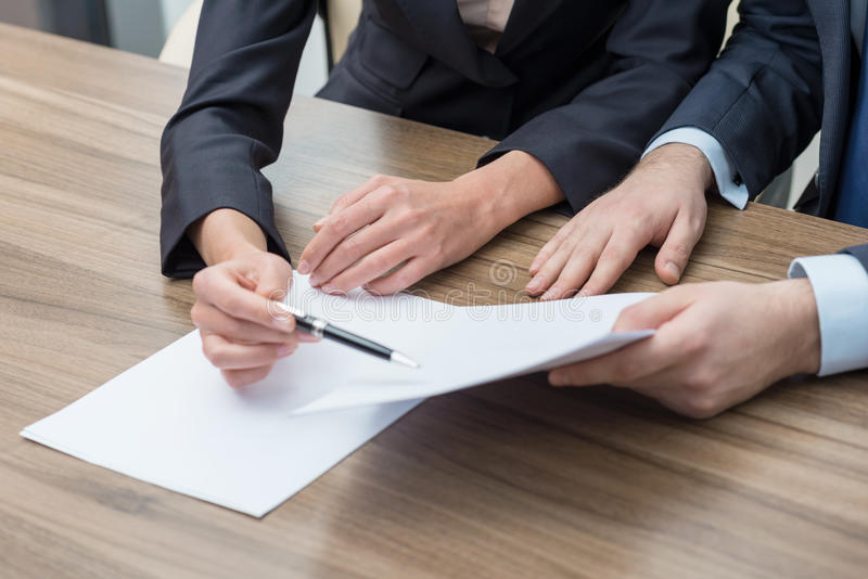 Business colleagues are working on the papers. stock photo