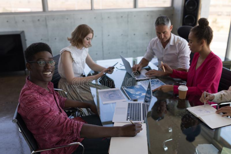 Business colleagues working together in office stock photo