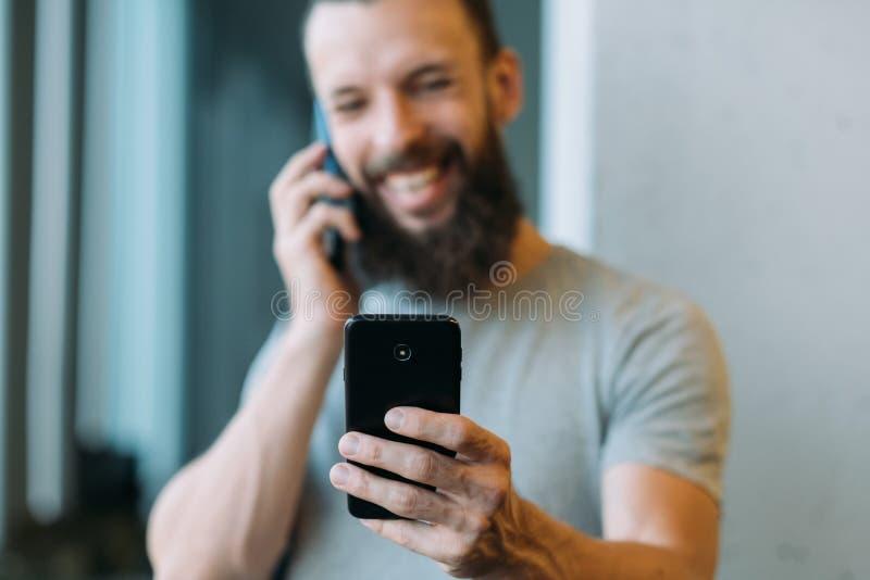 Business communication bearded guy smartphone stock photos