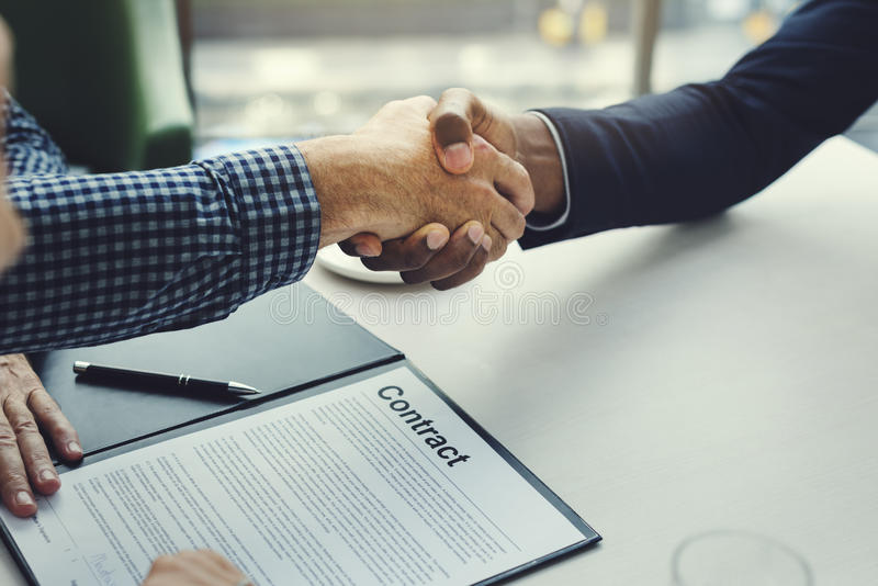 Business Communication Connection People Concept. Handshake is happening after sign a contract royalty free stock images