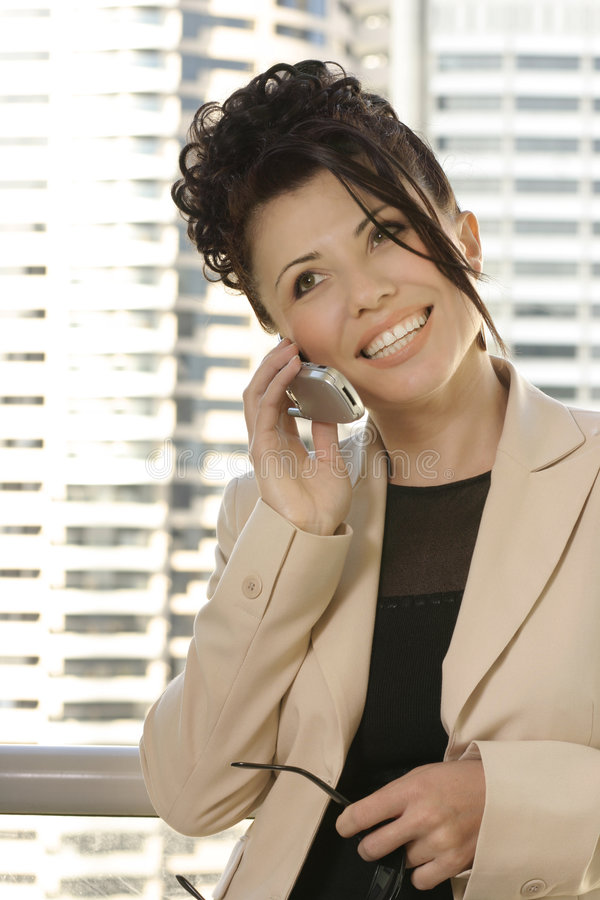 Business communications. Businesswoman on mobile phone royalty free stock photo