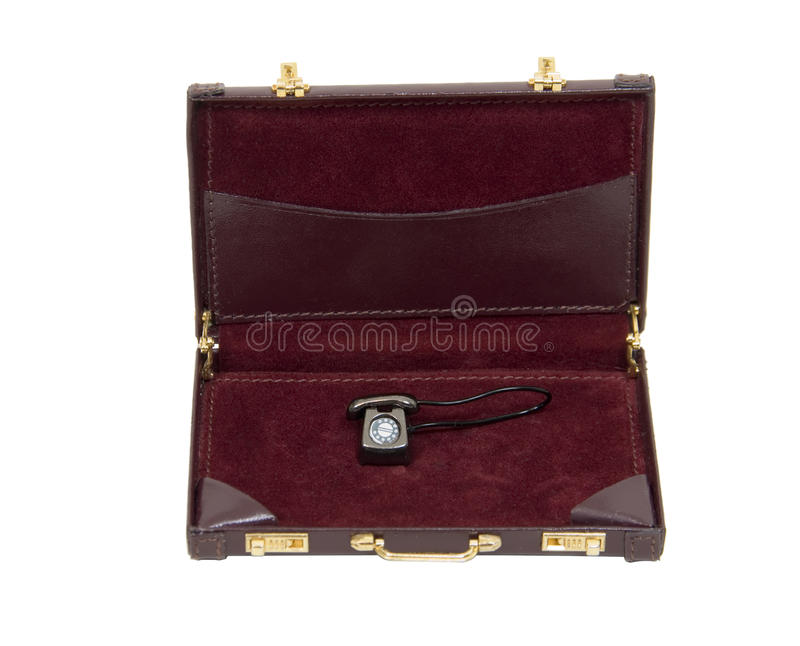 Business communications. Traditional desk phone with rotary dial in a leather briefcase showing communications - path included stock photography