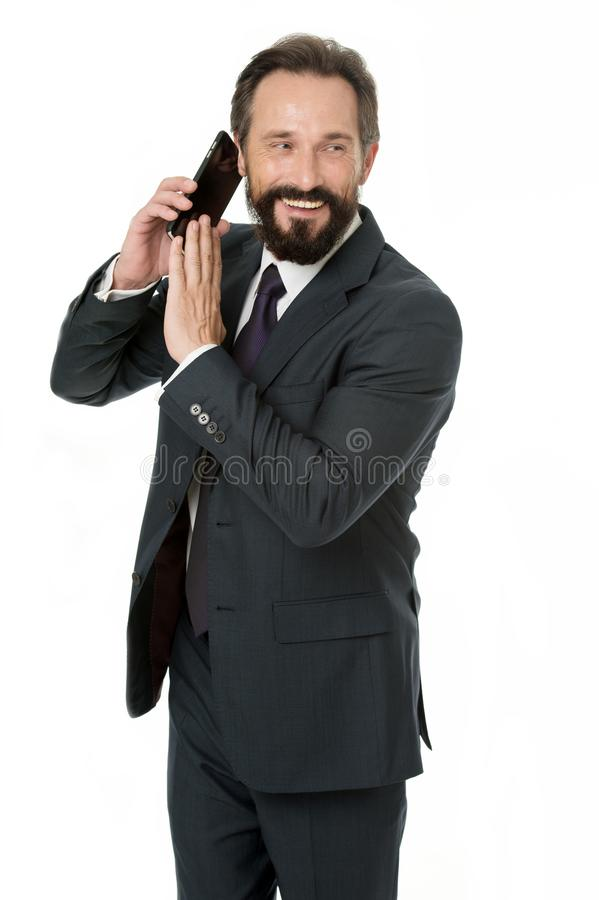 Business communications. Wait a minute. Busy with conversation. Businessman formal suit holds smartphone. Man bearded royalty free stock photos