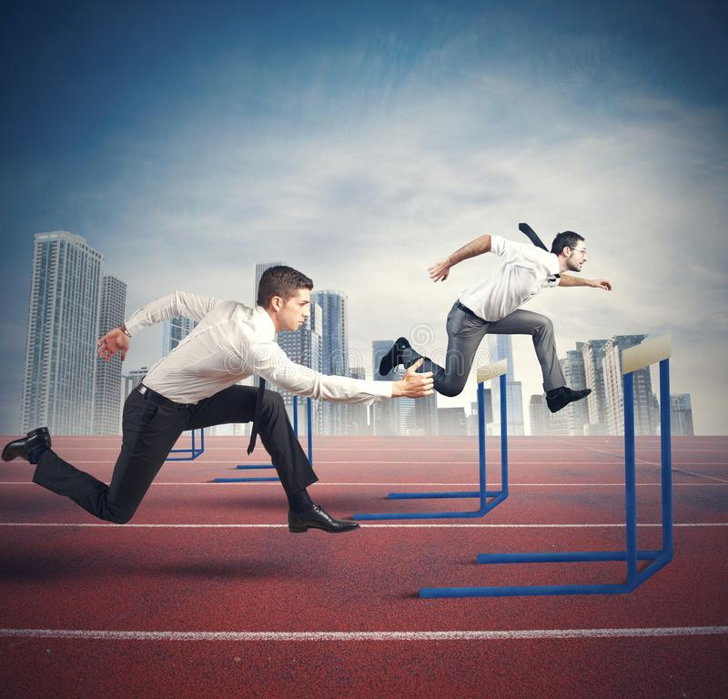 Business competition. Concept of business competition with jumping businessman royalty free stock image
