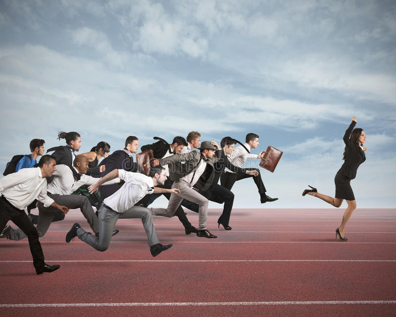Business competition. Businesswoman exults winning during a race with opponents royalty free stock photos