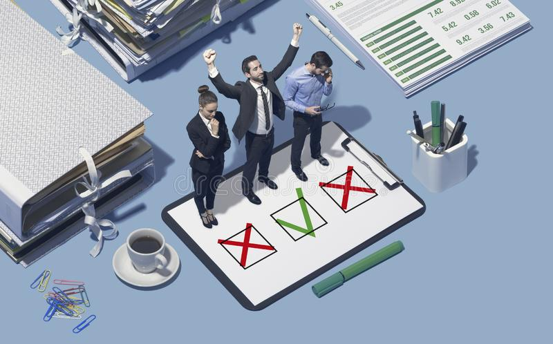 Business competition and challenge. Business competitors standing on a clipboard, one of them has won the contest and is celebrating with raised fists royalty free stock photo