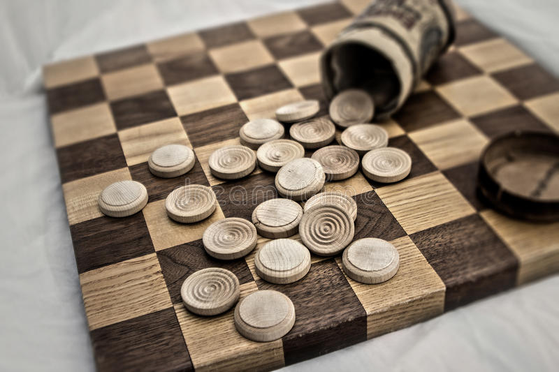 Business competition chess board concept in grainy faded old time look. royalty free stock photography