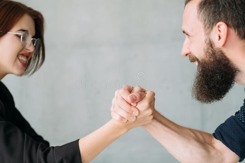 Business competition gender fight opponents. Business competition. Gender fight. Man against women in business. Struggling powerful opponents stock photo