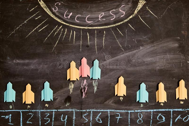 Business competition, rivalry, challenge or dispute. Success and strategy concept. Paper rockets fly to the success.  stock image