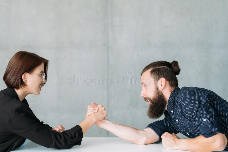 Business competition struggle powerful opponent. Business competition. Powerful opponents. Man against woman. Gender equality royalty free stock photo