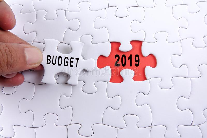 Business concept: 2019 BUDGET word on a jigsaw puzzle background royalty free stock photo