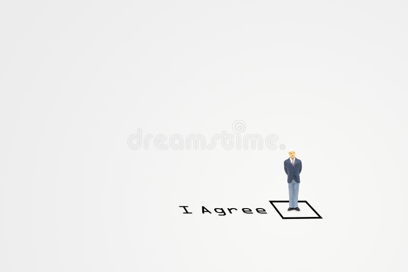Businessman standing in checkbox of agreement wording. Business Concept : Businessman standing in checkbox of agreement wording stock photo