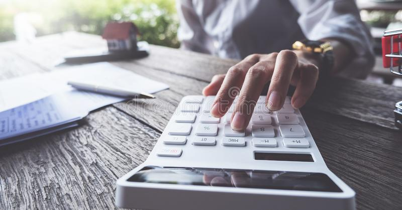 Business concept, Businessman using calculator to calculate loan plan stock image