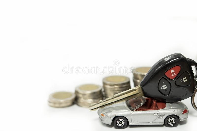 Business concept of car loan, gray car and stacks of coins. Money management for car concept, finance concept trade car for cash, isolated on white background royalty free stock images