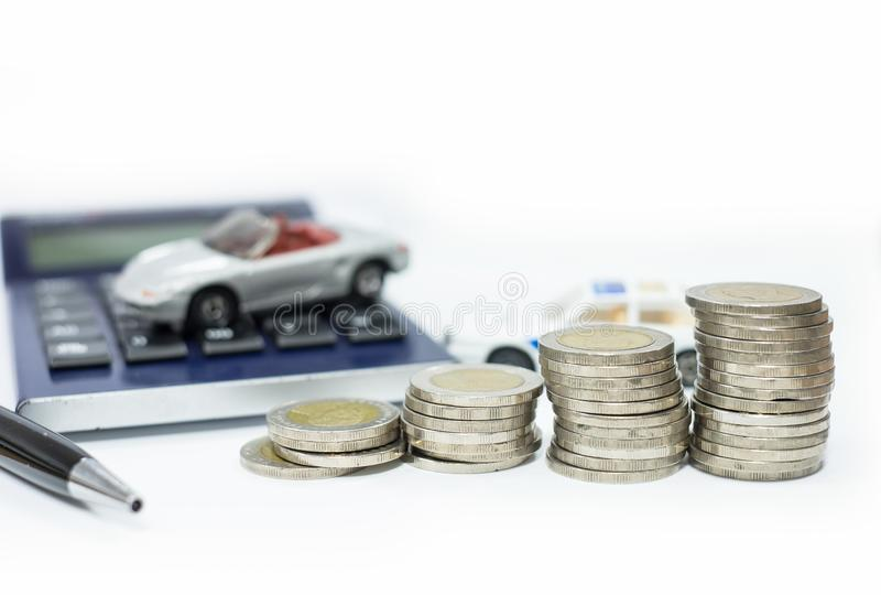 Business concept of car loan, gray car and stacks of coins. Money management for car concept, finance concept trade car for cash, isolated on white background stock photo