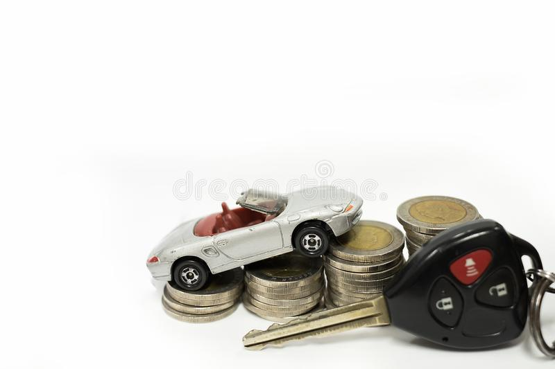 Business concept of car loan, gray car and stacks of coins stock images