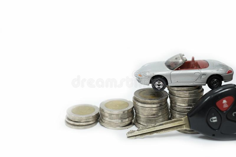 Business concept of car loan, gray car and stacks of coins. Money management for car concept, finance concept trade car for cash, on white background stock photo