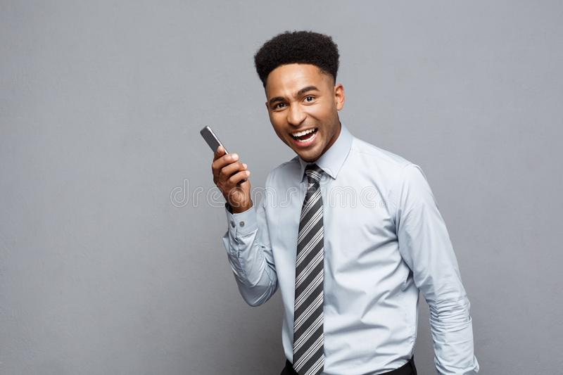 Business Concept - Cheerful professional african american businessman happy talking on mobile phone with client. royalty free stock image