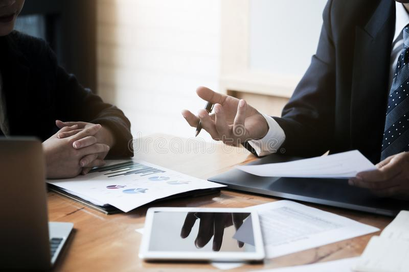 Business concept. Close up. Businessman advice to team with paperwork to analyzing budget plan and statistic stock photo