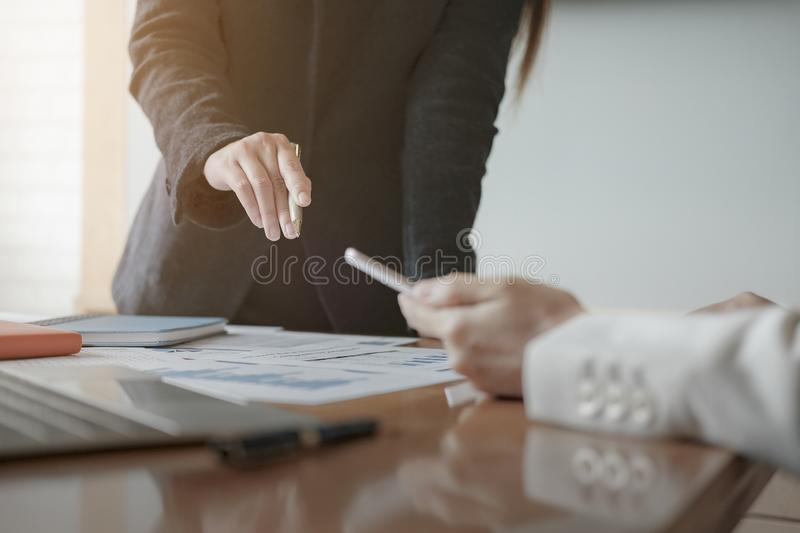 Business concept. Close up. Businessman advice to team with paperwork to analyzing budget plan and statistic royalty free stock photography