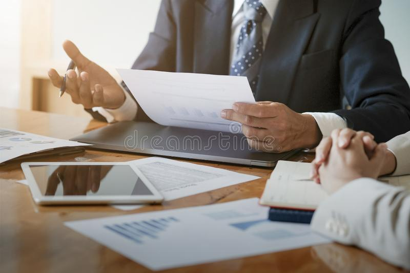 Business concept. Close up. Businessman advice to team with paperwork to analyzing budget plan and statistic royalty free stock images