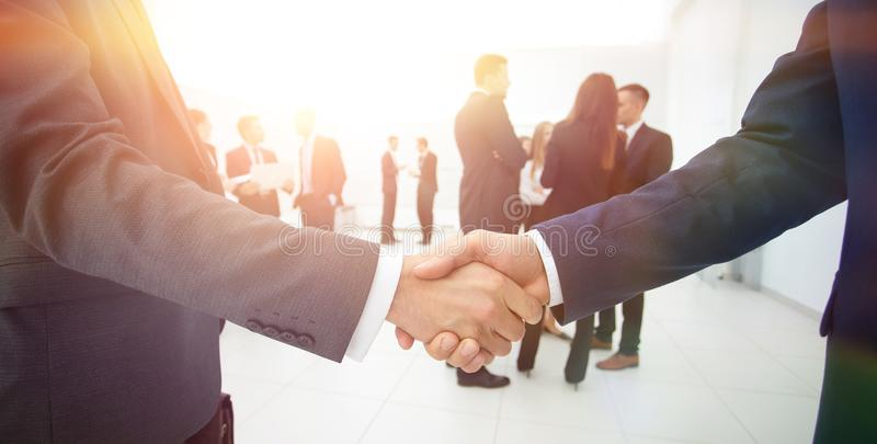 Closeup of handshake of business partners on the background of b stock photos