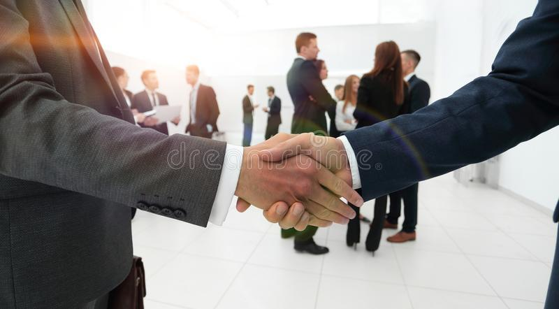 Closeup of handshake of business partners on the background of b royalty free stock photo